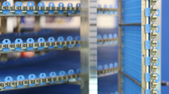 Many horizontal and vertical moving blue industrial conveyors Stock Footage