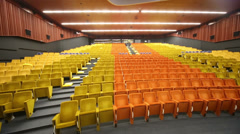 Empty big auditorium with many rows of yellow and soft seats Stock Footage