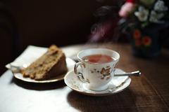 Traditional tea and cake on wooden cafe table Stock Photos