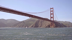 Golden Gate bridge from water below slow motion Stock Footage