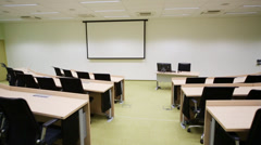 Background for projector in small modern auditorium with desks Stock Footage