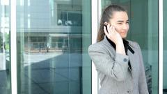 Business woman phone before bussines building Stock Footage