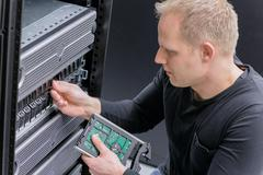 IT Consultant install new SAN hard drive Stock Photos