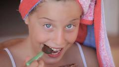 Gourmand child girl eating chocolate Stock Footage
