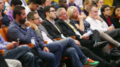 Attentive viewers at Global Youth to Business forum - stock footage