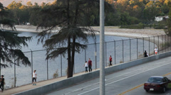 Silver Lake Reservoir in Afternoon - People Jogging By Stock Footage