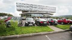 Cars near building of Russian Business School Skolkovo Stock Footage