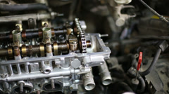 Closeup of disassembled complicated gasoline car engine - stock footage