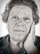 Face of an old woman - black and white portrait with dragan effe - stock photo