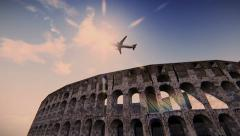 Airplane flying over the Colosseum - stock footage