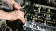 Hands of mechanic repairing gasoline car engine Stock Footage
