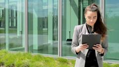 Business read in clipboard(paper) before business building Stock Footage
