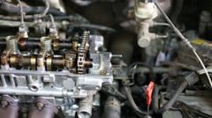 Closeup of disassembled complicated gasoline car engine Stock Footage