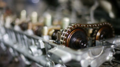 Closeup of disassembled gasoline car engine with moving gears Stock Footage