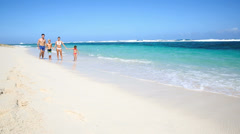 Family running on a beach Stock Footage
