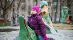 Anya plays in playground with sculptures Krylovs fables Stock Footage