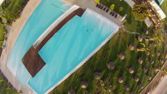 Flying over an empty pool in Greece resort Stock Footage