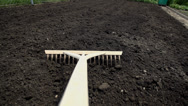 Stock Video Footage of Point of view using the wooden rake on the garden