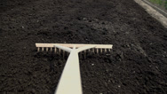 Stock Video Footage of POV of using the rake on the black soil