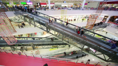 Many customers move at escalators in big modern mall Stock Footage