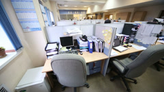 Armchairs, desktops at workplaces separated by partitions Stock Footage