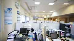 Desktops and many papers at workplaces separated by partitions Stock Footage
