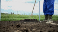 Stock Video Footage of Close low angle shot of earth moving under the rakes
