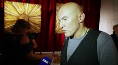 Igor Matvienko is interviewed before premiere popular musical Stock Footage