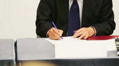 Male hands in suit at table sign documents at business meeting Stock Footage