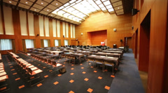 Empty hall with stage, many rows of chairs for business meeting Stock Footage