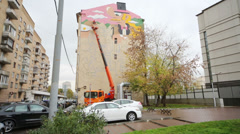 Artist paints with inks multi-storey building on Astrakhan lane. Stock Footage