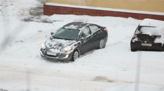 Car skidding in snow at winter snowy day. Above view Stock Footage