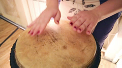 Women hands beat leather-covered ethnical drum indoor Stock Footage