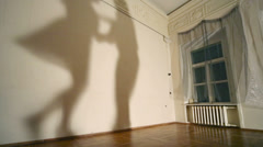 Silhouettes shadows of woman and man dancing boogie-woogie move Stock Footage