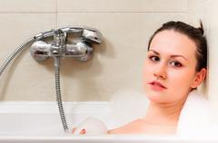 Closeup of a young woman in the bathroom Stock Photos