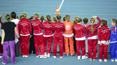 Back of girls in red at children competition under auspices Stock Footage