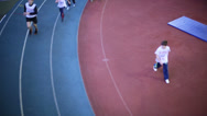 Stock Video Footage of Children run on track at competition under auspices
