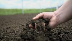 Detail shot of gardener checking the quality of the soil in his garden - stock footage