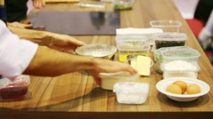 Male hands laid containers with different foods to cook meal Stock Footage