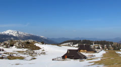 Mountain pasture with snow in early spring Stock Footage