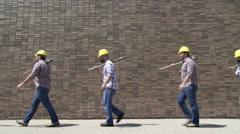 Endless Looping Line of Workmen Walking - stock footage