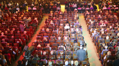 Big audience and moving colored lights at concert. Top view Stock Footage