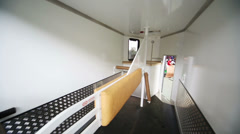 Interior of trailer for transportation of horses on exhibition Stock Footage