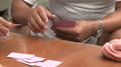 Card players gamble in the street 1 - stock footage