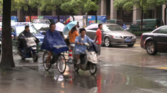 Wet commuters walk, ride and drive to work Stock Footage