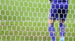 White football grid, back of goalkeeper warming up on match Stock Footage