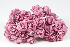 collection of pale pink artificial paper roses - stock photo
