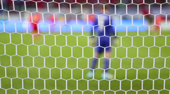 football grid, back of goalkeeper and other players on match - stock footage