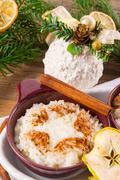 Stock Photo of milk rice with cinnamon and applesauce