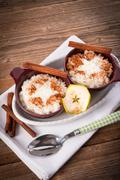 Stock Photo of milk rice with cinnamon and applesauce
